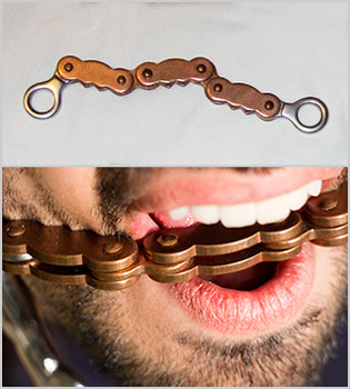 Bike chain horse bit. The mouthpiece (top) and me wearing it (bottom)