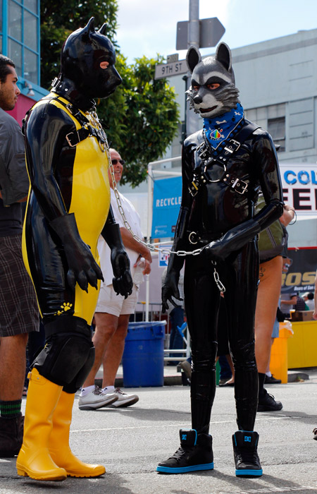 Two latex pups waiting for the cavalcade to begin