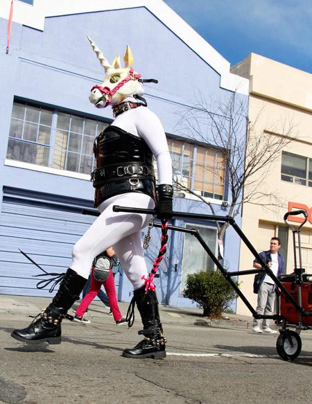 Latex unicorn pulling a wagon