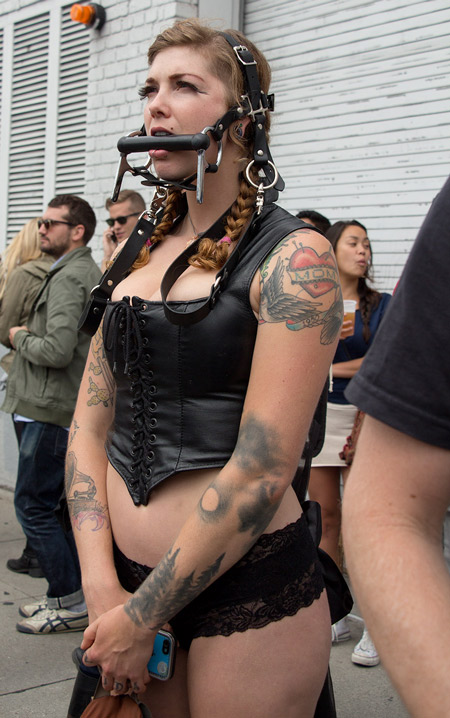 Ponygirl watching a fashion show at Folsom 2014