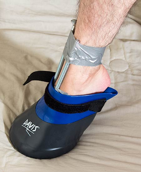 Insert or force the foot with taped bolt into the soaking boot