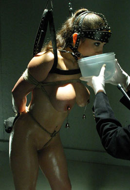 Ponygirl drinking through her bit gag after running on a treadmill