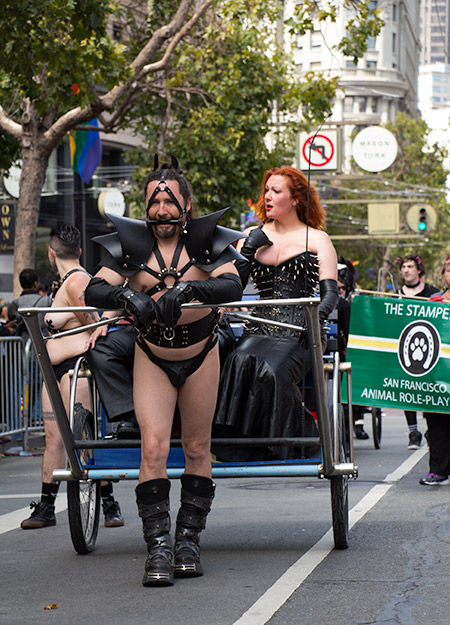 SParky pulling his mistress during the 2015 San Francisco Pride aprade
