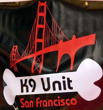 The banner of the SF K9 unit hanging above the play area near Folsom St