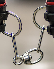 Heavy duty livestock grade chain and swivel link connect the leather cuffs of the hobbles