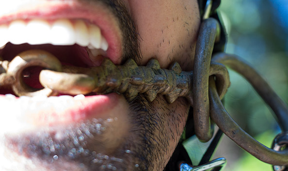 Me wearing my new spiked horse bit. This closeup of the mouthpiece shows the spikes and joint. The two rings on each side make this a Wilson snaffle bit.